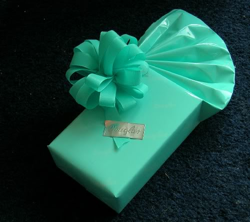 Een groen Douglas cadeautje, wat zou daar in zitten?
